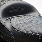 "The Black/Studded Heated Extended Reach Seat provides comfortable seating and customized ergonomics for taller riders and riders who like to ride with their legs fully stretched out to the foot pegs and lower controls. The specially shaped cushioning in this seat elevates the rider to a higher seating position and sets the rider 2"" farther back than the stock seating location. As a result, the rider has an extended reach from the seat to the foot pegs and lower controls, which enhances comfort for riders who are taller or have longer legs. Most comfortable seat on the market for riders over 6'3"". Moves the rider up and back. Hi/Lo/Off heat control is easily accessible. When packaged with the mid rise bars (2881932-410 or -266 sold separately) we can offer the ultimate extended reach package. The seat uses the Roadmaster seat pan but is modified for use with a backrest if you choose to remove your trunk."