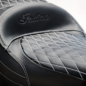 """The Black/Studded Heated Extended Reach Seat provides comfortable seating and customized ergonomics for taller riders and riders who like to ride with their legs fully stretched out to the foot pegs and lower controls. The specially shaped cushioning in this seat elevates the rider to a higher seating position and sets the rider 2"""" farther back than the stock seating location. As a result, the rider has an extended reach from the seat to the foot pegs and lower controls, which enhances comfort for riders who are taller or have longer legs. Most comfortable seat on the market for riders over 6'3"""". Moves the rider up and back. Hi/Lo/Off heat control is easily accessible. When packaged with the mid rise bars (2881932-410 or -266 sold separately) we can offer the ultimate extended reach package. The seat uses the Roadmaster seat pan but is modified for use with a backrest if you choose to remove your trunk."""